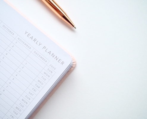 close up photo of yearly planner beside a pen 1558691